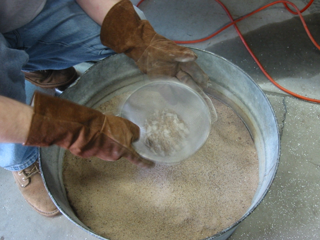 (18) A sifter is used to clean the chips of mud out of the sand.