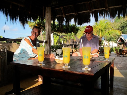 enjoying our Canouan Dream cocktails at the Pirate Cove bar, with Penny & Geoff