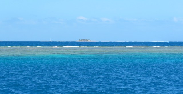 The reefs surrounding Namotu, Cloudbreak out there on the horizon