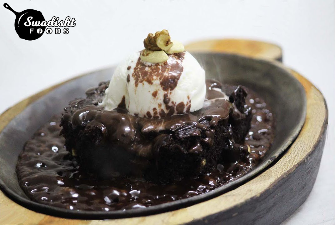 Sizzling brownie with Chocolate sauce and Vanilla Ice cream