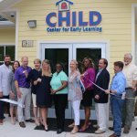A group of community leaders cuts the ribbon on the CHILD Center's new facility