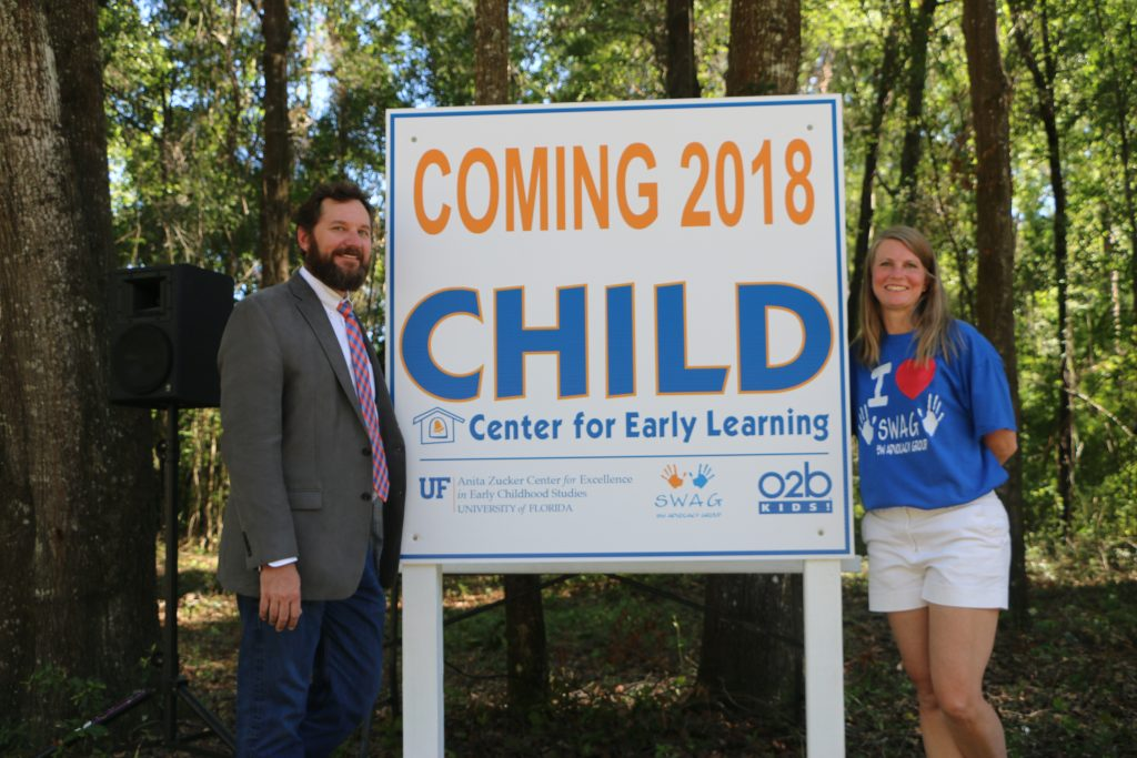 """Dorothy Thomas stands with a community partner next to a sign that reads, """"Coming 2018: CHILD Center for Early Learning."""""""