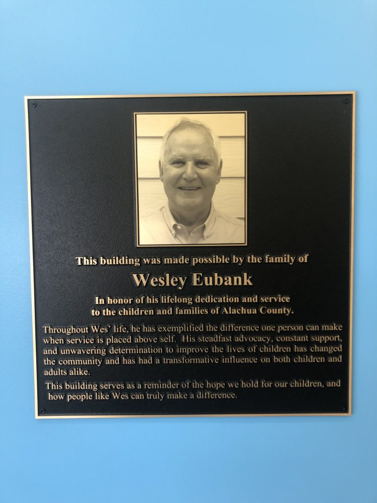 A sign honoring the contribution of Wesley Eubank's family to the CHILD Center facility.