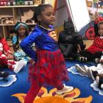 A CHILD Center student wearing a Supergirl costume