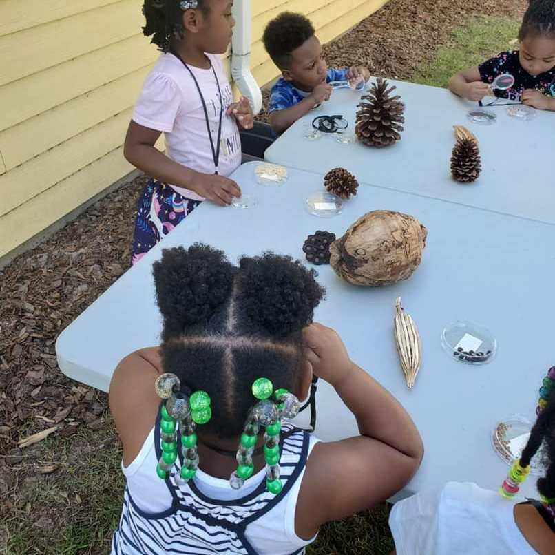 CHILD Center students get hands-on experience with plants during an outdoor gardening lesson in April 2021.