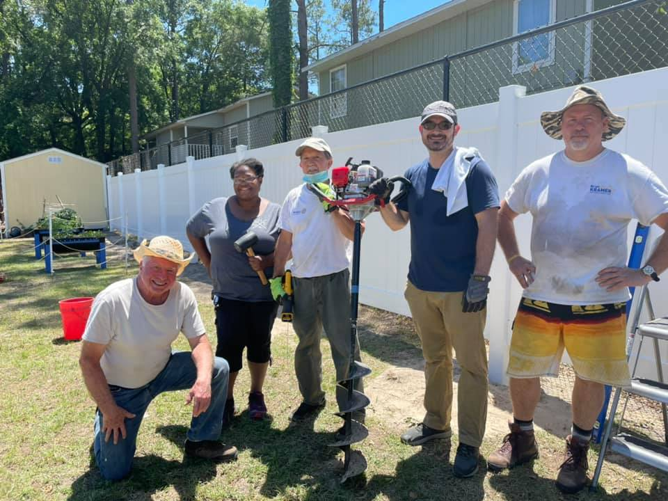Five volunteers from the Gainesville Rotary Club at the CHILD Center to help install a new fence during Summer 2021