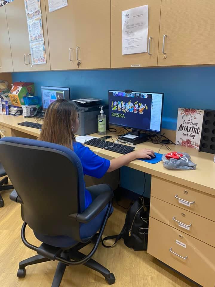 A CHILD Center staff member reviews training materials on a computer during the Summer 2021 teacher training