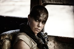 """CHARLIZE THERON as Furiosa in Warner Bros. Pictures' and Village Roadshow Pictures' action adventure """"MAD MAX: FURY ROAD,"""" a Warner Bros. Pictures release. (Jasin Boland)"""