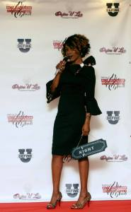Lifestyle designer Valenica Wallace-Griffin in dress designed by Kenya Kersey.