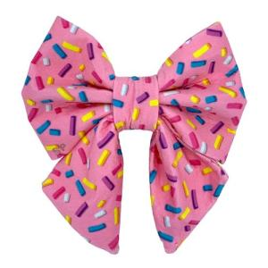 pink sprinkles fun print for dog sailor bow tie. Pink background color with multi colour sprinkles all across