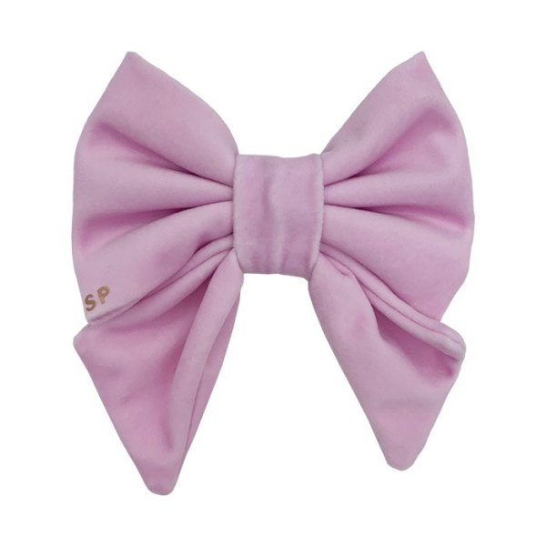 Front side of the pink sailor dog bow. Luxury light pink pastel velvet in the sailor dog bow shape