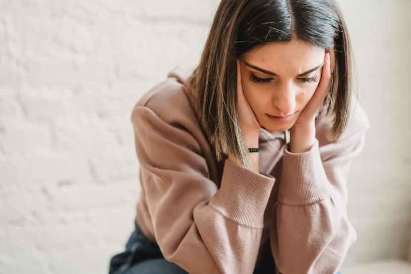 sad woman sitting in room