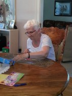 Arlene doing a puzzle - FL sibling reunion 2013