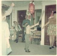 Christmas 1967 at Ed's-Steve whacking pinata made by Carolyn