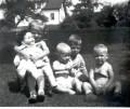 Ingrid, Phil, Ed and George as children