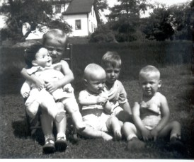 Ingrid, Phil, Ed and George as children