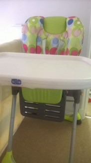 High chair with tray.