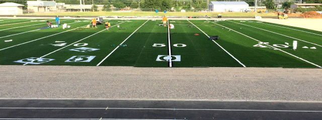 By Monday morning, much of the field was covered, leaving the sidelines and the north end from about the 30-yardline.