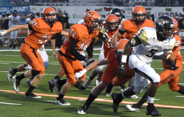 Nashville defenders pursue the De Queen ball carrier Friday night during the Scrappers' non-conference victory over the Leopards. Nashville is 2-0 on the season; De Queen is 1-1.