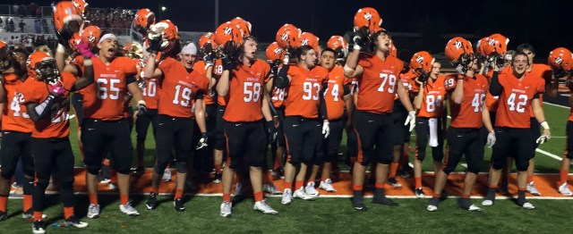 The Scrappers sing their fight song in front of the home stands after defeating Idabel 91-63 Friday night at Scrapper Stadium.