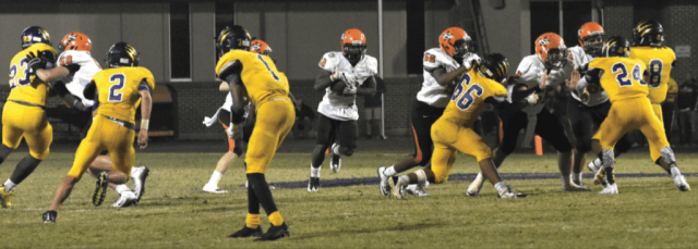 Scrapper offensive linemen clear the way for Darius Hopkins (12) on the fourth quarter drive which ended with Hopkins scoring the game-winning touchdown in Nashville's 56-51 come-from-behind victory.