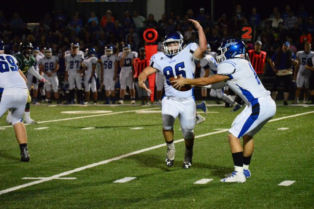 Dierks Outlaw running back Brayden Kirby (86) fakes a handoff with quarterback Caleb Adams during action Friday night.