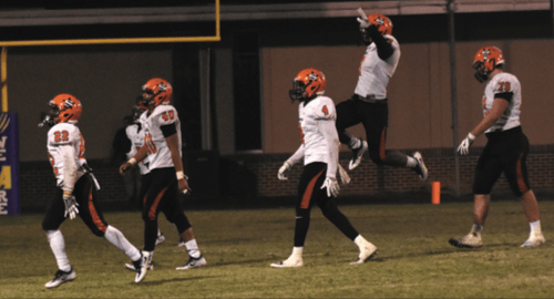 Scrapper defenders leave the field after recovering an Ashdown fumble in the closing seconds Friday night.