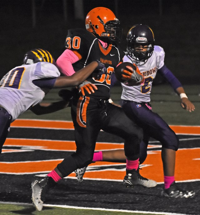 Jacobi Jefferson (30) scores for the junior Scrappers during their 42-6 victory over Ashdown Oct. 13 at Scrapper Stadium. The juniors' winning streak stands and 53 games.