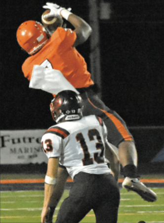 CJ Spencer goes up for the catch Friday night against Pea Ridge.