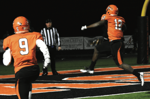 Darius Hopkins (12) scores 1 of his 4 touchdowns Friday night in the state playoff game against Pea Ridge at Scrapper Stadium.
