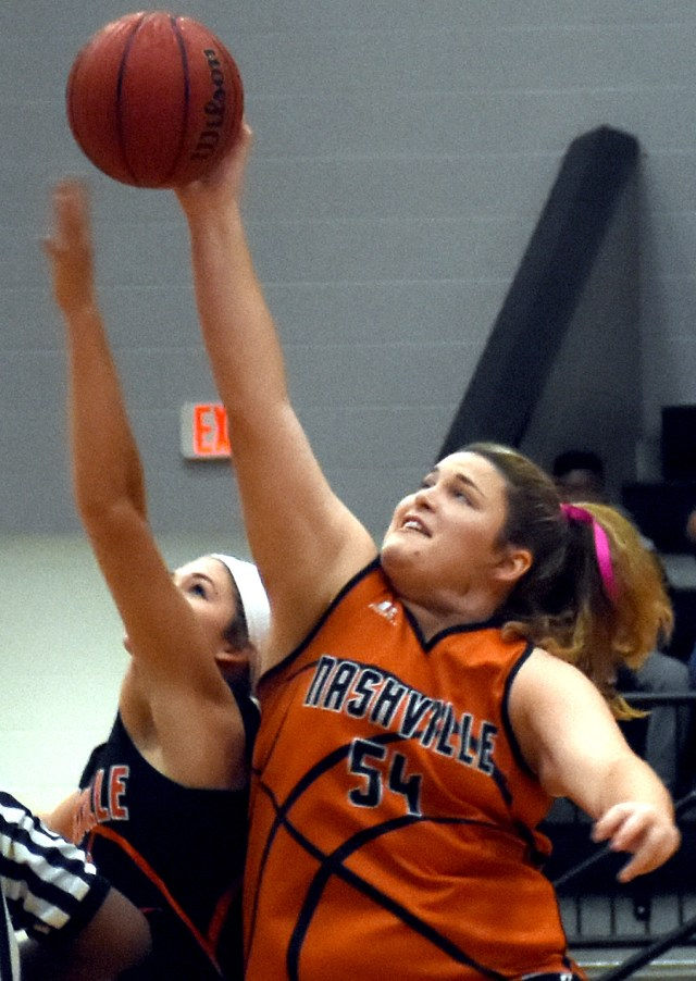 Madi Miller and Alyssa Harrison vie for the tip at the Orange and Black Scrimmage.