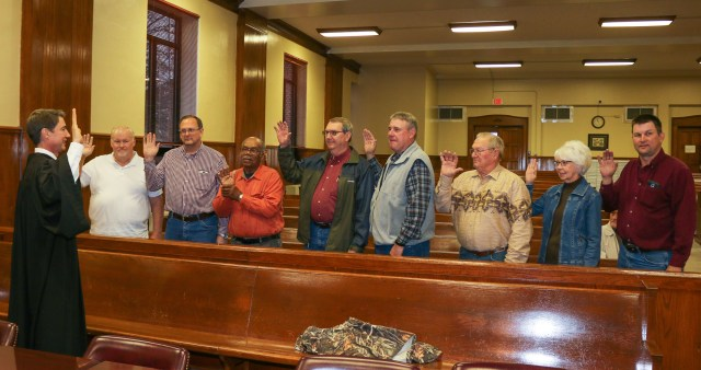 Justices of the Peace who were sworn in Jan. 2 by Judge Tom Cooper, at far left, included Jerry Harwell, Brent Pinkerton, Bobby Don Turner, Gary Welch, Kerry Strasner, Dick Wakefield, Janice Huffman and Kirk Bell. Welch and Bell are first-termers on the court.