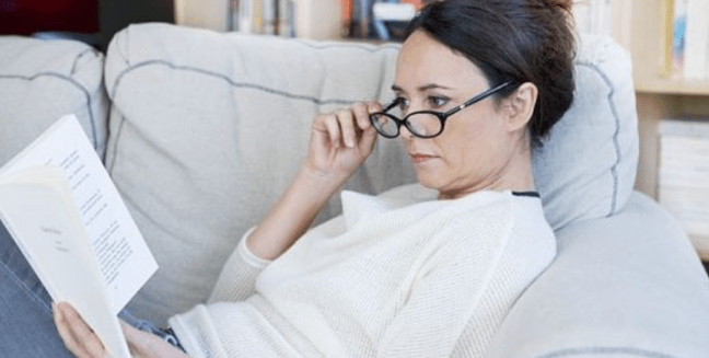 Sandwich Generation Woman relaxing reading a book