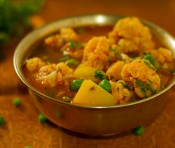 Cauliflower, peas, and potatoes in thin gravy - Aloo Gobhi Jhol