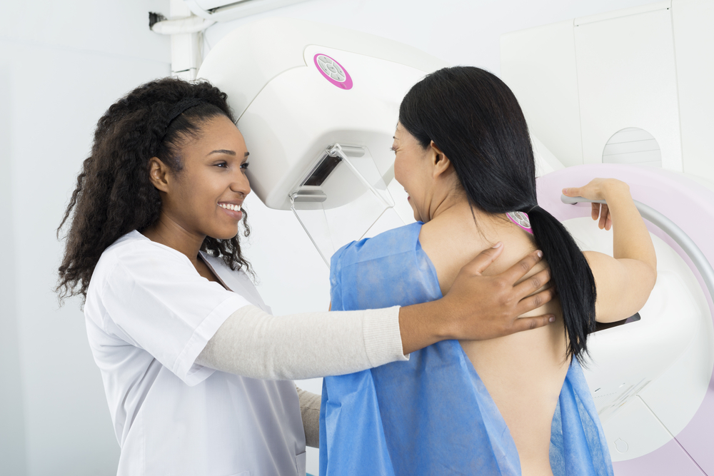 Happy,Doctor,Assisting,Woman,Undergoing,Mammogram,X-ray,Test