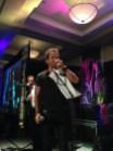 Sebastian Roche singing.