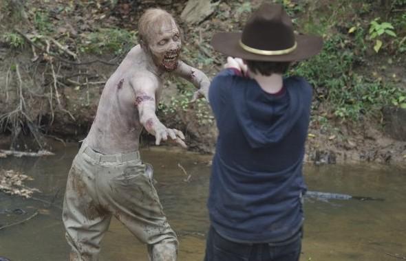 Walking Dead Carl shoots walker