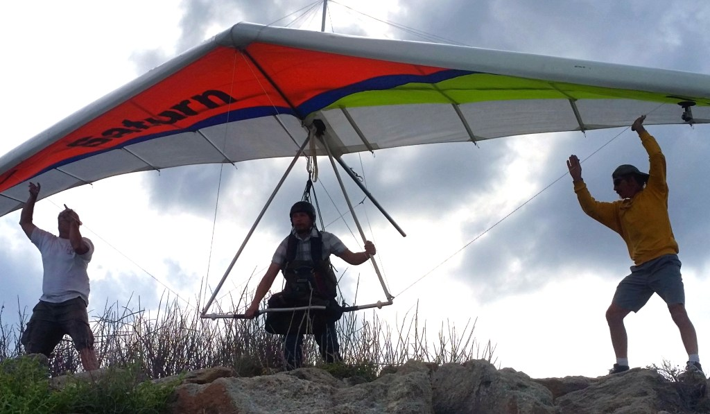 Eric Meibos launching a hang glider from New Smyrna Beach