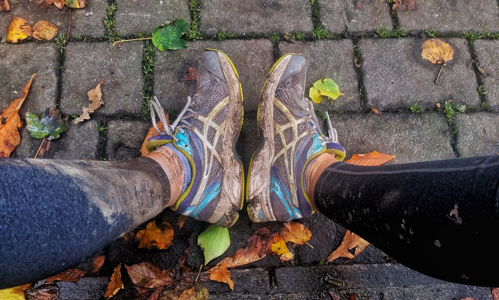 Earlier in the day, I had been running with my Chacos on, and dealt with calf-high mud, which you can see by the mud line on my left leg. I would trade out shoes during the day as the terrain changed along the Kerry Way. Photo: Sara Weaver, Oct. 2017.