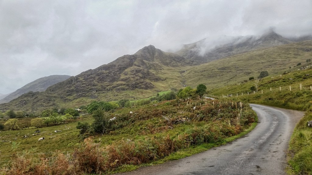 Wet, rocky, black peaks stand sentinel over the Kerry Way as it weaves through the surreal Black Valley. It was a cold and wet morning, but the weather was supposed to clear later in the day. With some of the most challenging and dangerous trail later this day, I was hoping it would. Photo: Sara Weaver, Sept. 2017.