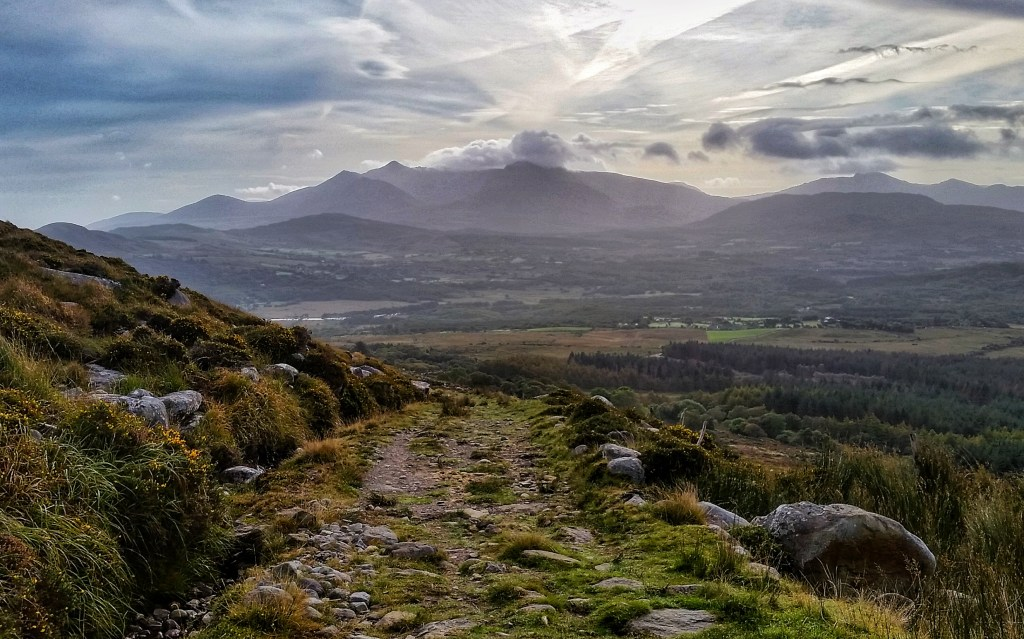Looking back on the rocky Kerry Way from Windy Gap. MacGillycuddy's Reeks stick out into the clouds in the distance. Photo: Sara Weaver, Oct. 2017.