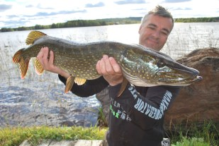 pike lake fishing northern sweden holiday