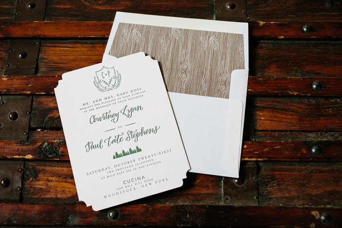 The Woodland design is ideal for a woodsy celebration with natural touches. This original version features letterpress printing, calligraphy accents and a unique die-cut shape.