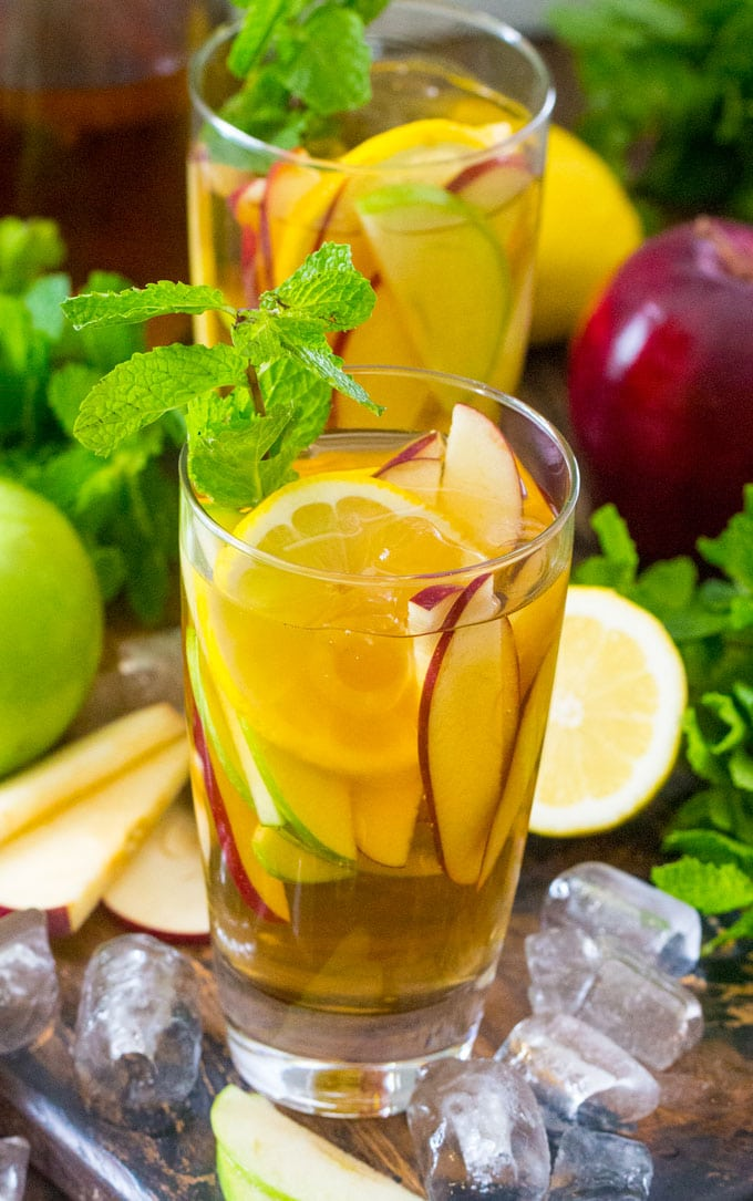 Boozy Apple Iced Tea is the best way to combine a little booze with you favorite fall flavors. Bright and refreshing, this is the perfect fall cocktail.
