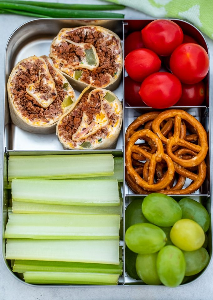 Cuban Sausage Pinwheels are great for parties or lunchboxes! Serve this dish as an appetizer or simple snack that is loved by both kids and adults alike! #sausage #lunchbox #lunchideas #sweetandsavorymeals #fingerfood