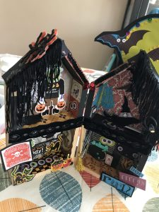 This is a paper decorated house with a Halloween theme.