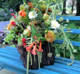 Large arrangement set in preserved tree trunk