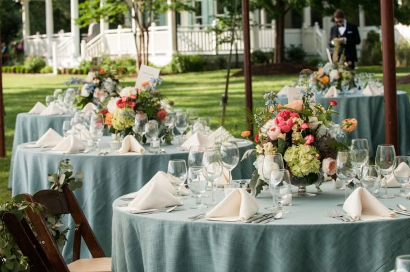 Bright and elegant centerpieces for reception tables - Photo by Melissa Grimes-Guy Photography.