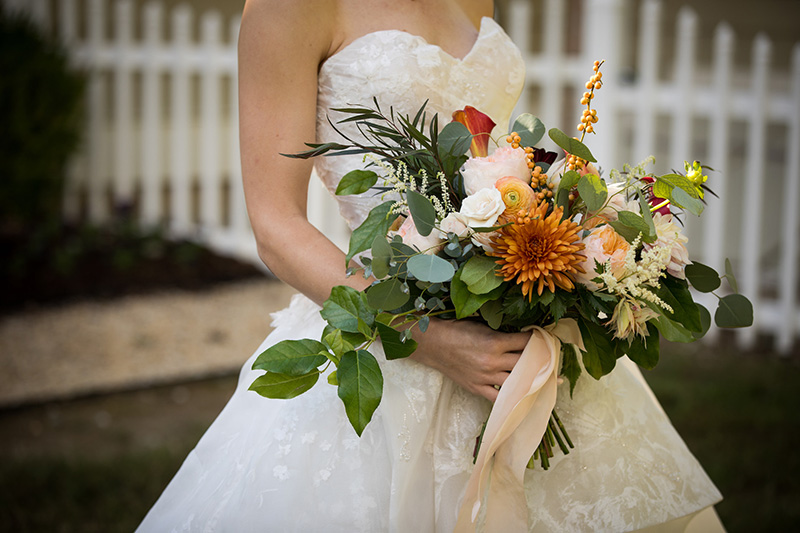 Bride holding her colorful Bridal Flowers by Sweetbay Flowers | Eastern Shore Florist|