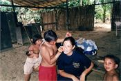 Marvelys Lopez, medical doctor getting her face painted by a Yanomami woman in the Venezuelan Amazon.